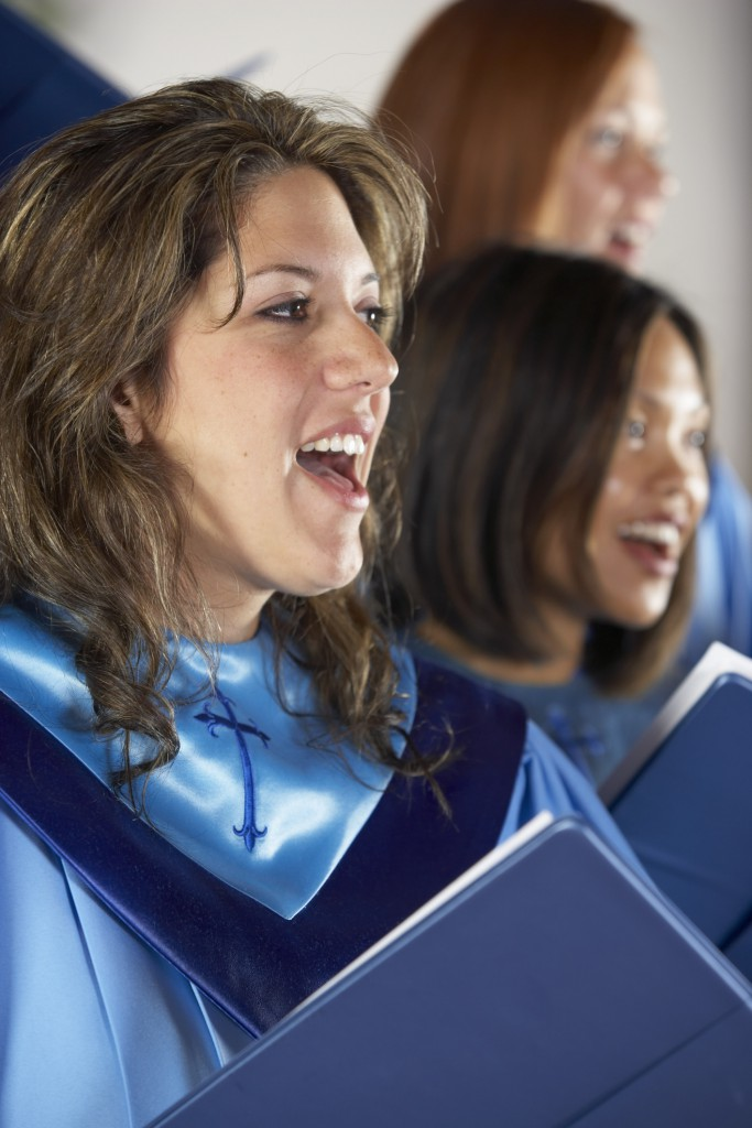 Woman in church choir singing